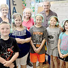 KEVIN HARVISON | Staff photo<br /> Local Modern Woodmen members are pictured with Will Rogers students. The local chapter recetnly provided assistance to Will Rogers Elementary School through the organization's Service Project Program. Members bought school supplies and the chapter provided headphones for the students. Modern Woodmen was founded in 1883, since that time Modern Woodmen has brough people together, supported families and strengthened communities nationwide.