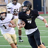 KEVIN HARVISON | Staff photo<br /> McAlester 9th grade quarterback Trent Boatright gets around a Broken Bow defender during football action at Hook Eales Stadium Thursday evening.