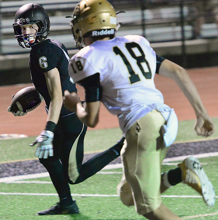 KEVIN HARVISON | Staff photo<br /> Landon Willis, a 9th grade reciever for the Buffaloes, scores a touchdown Thursday evening at Hook Eales Stadium.