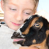 Kevin Harvison | Staff photo<br /> McAlester 4-H Cloverbud, Jane Hale, hugs her goat during the Pittsburg County Free Fair.
