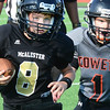Kevin Harvison | Staff photo<br /> McAlester third grade quaterback Kellen Hearod runs the ball around the corner for a big gain against Coweta Saturday at Jeff Lee Stadium.