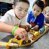 Kevin Harvison | Staff photo<br /> Pictured from left are McAlester Public School students, Jayden Self, Salvador Garrid and Commor Smead work together to build a railway during a recent indoor recess.