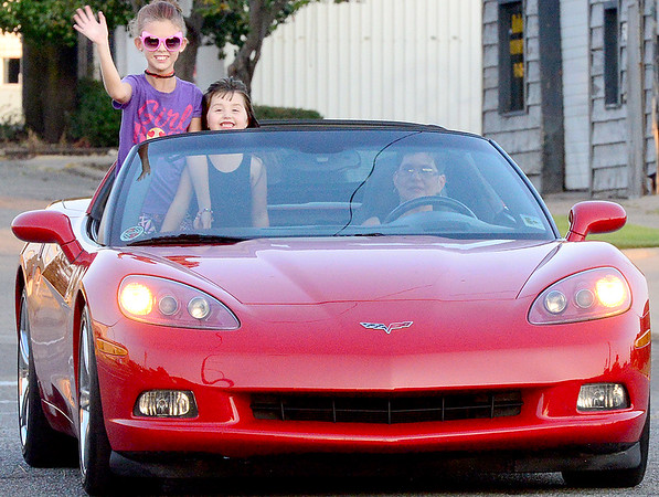 "Kevin Harvison | Staff photo<br /> Pictured from left Ava Seymour, Madison Southerland enjoy being ""cruised"" around during cruise night Friday in McAlester by Joyce Morris."