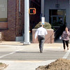 ADRIAN O'HANLON lll | Staff photo<br /> An unidentified woman runs across the newly-installed high-intensity activated crosswalk (HAWK) signal in front of the Pittsburg County Courthouse on Carl Albert Parkway Thursday.