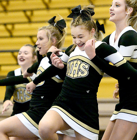 Kevin Harvison | Staff photo<br /> Kaylee Waller, center, reacts during a McAlester High School Cheerleading routine Tuesday night as she falls back into  Kamryn Higgs-Lenard, right. The MHS squad is preparing to perform for 2017 Regional Cheer Championships competition Saturday in Bixby.