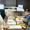 Kevin Harvison | Staff photo<br /> Sitting top far right, Robert Ray, Pricinct 35 clerk and seated bottom right, Minne Lynn Scott, Pricint 35 judge help voters in the First Christian Church in Hartshorne.