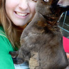 Kevin Harvison | Staff photo<br /> Pittsburg County 4-H Ambassador Skyla Edwards gets a kiss from her pet rabbit during the Pittsburg County Free Fair.