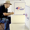 Kevin Harvison | Staff photo<br /> Hartshorne voter Ricky Maddux places his vote during Hartshornes city election.