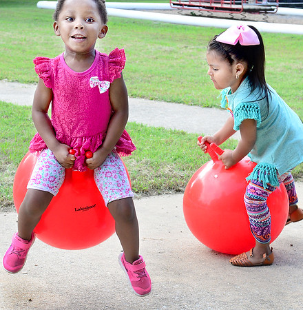 Kevin Harvison | Staff photo<br /> Pictured left, Washington Early Childhood Center Head Start student Kiarra Mace gets some air while bouning around the WECC playground.