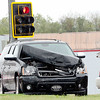 Kevin Harvison | Staff photo <br /> Pictured is one of the vehicles involved in a two vehicle accident at the intersection of 6th Street and Carl Albert Parkway Thursday morning.