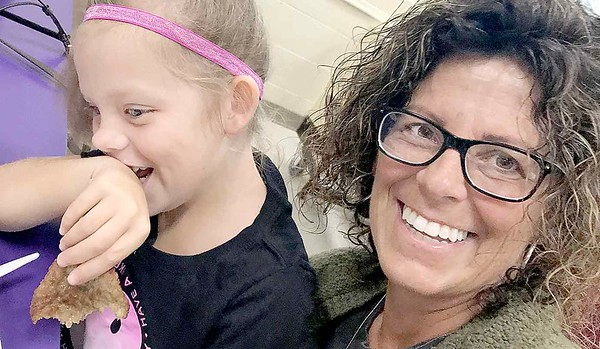 KEVIN HARVISON | Staff photo<br /> Aleigha Smart, left, attempts to compose herself before posing for a photo with Grandparent Didi Smart Friday at Edmond Doyles Grandparents breakfast day.