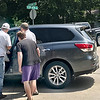 KEVIN HARVISON | Staff photo<br /> Citizens pry the door open as they come to the aid of a driver involved in a traffic accident Saturday at the intersection of Strong Boulevard and Comanche Avenue.