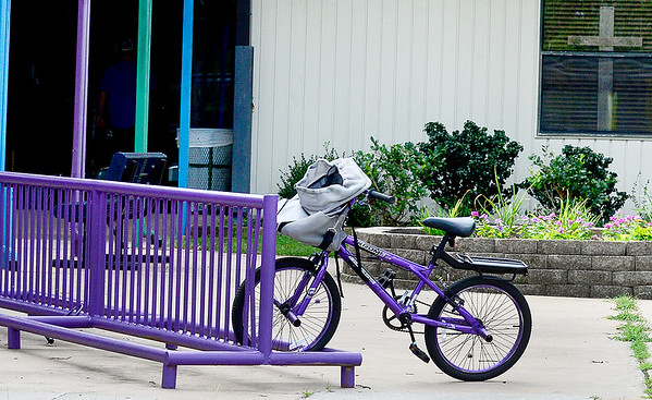 KEVIN HARVISON | Staff photo<br /> Picutred at Will Rogers Elementary school a bike is parked on the bike rack outside the front of the school.