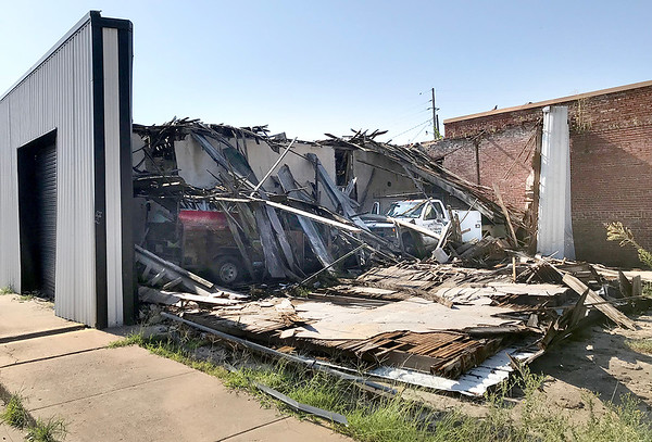 KEVIN HARVISON |<br /> A storage building for Humphry Plumbing is pictured after a storm destoyed the building that sit near the corner of Chickasaw Avenue and Main Street in McAlester.
