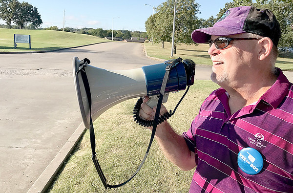 KEVIN HARVISON | Staff photo<br /> McAlester Regional Health Center CEO David Keith, uses a mega phone to get attention for a State Question 802 petition during his day off.