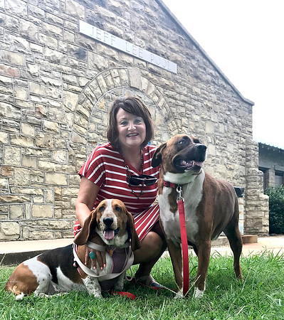 KEVIN HARVISON | Staff photo<br /> Peggy DeFrange poses with her pool pets anticipating the Pooch in Pool event.
