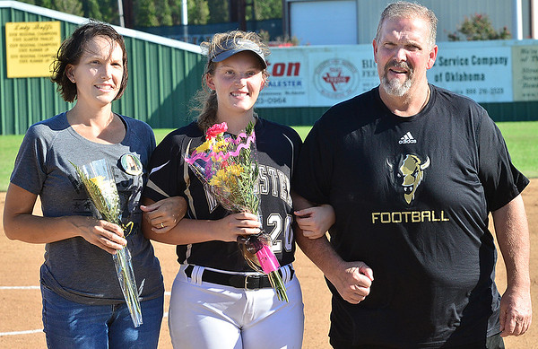 KEVIN HARVISON | Staff photo<br /> McAlester High School honored it's senior softball girls Friday. Pictured from left, Kathy Faber, MHS Senior Katelyn Faber and Charles Faber.