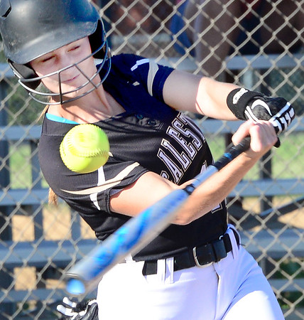KEVIN HARVISON | Staff photo<br /> A McAlester Lady Buff batter belts a base hit against Durant during a home game Friday.