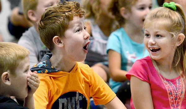 KEVIN HARVISON | Staff photo<br /> Members of the crowd react during a performance by Magician Marty Westerman Friday during the Pittsburg County Free Fair.
