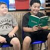 HAYDEN HARVISON | Submitted photo<br /> Connor Smead, left, reacts to Jayden Self, right, as Self reads a book during the Emerson Elementary School Family Night event Friday night.