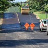 KEVIN HARVISON | Staff photo<br /> McAlester city crews work on East Tennessee Avenue from 9th Street laying down new asphalt Tuesday.