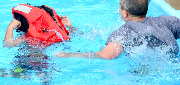 KEVIN HARVISON | Staff photo<br /> An example of a inproperly fit life jacket during the Water Safety Course at the McAlester Elks Lodge Tuesday.