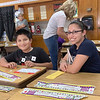 HAYDEN HARVISON | Submitted photo<br /> Adrian Ortiz, left, sits with his mother Maria Rosales, right, during the Emerson Elementary School Family Night event.