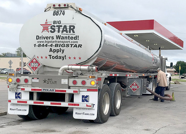 KEVIN HARVISON | Staff photo<br /> A new delivery of gasoline is transported to a local convience store. Gas prices are on the rise after an attack on Saudi oil field recently.