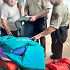 KEVIN HARVISON | Staff photo<br /> Pictured from left, Bryan Cox, President of the McAlester Elks Lodge #533, Trooper Scott Lee and Trooper Jamie Futral inspect life jackets during the Water Safety Course and Life Jacket Inspection event held at the Elks Club Tuesday.