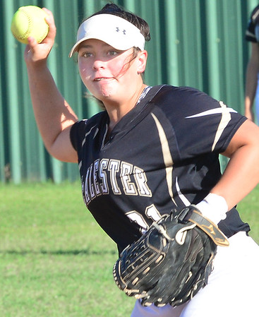 KEVIN HARVISON | Staff photo<br /> A McAlester Lady Buff infielder makes a play against Durant during McAlester's Senior NIght Friday.