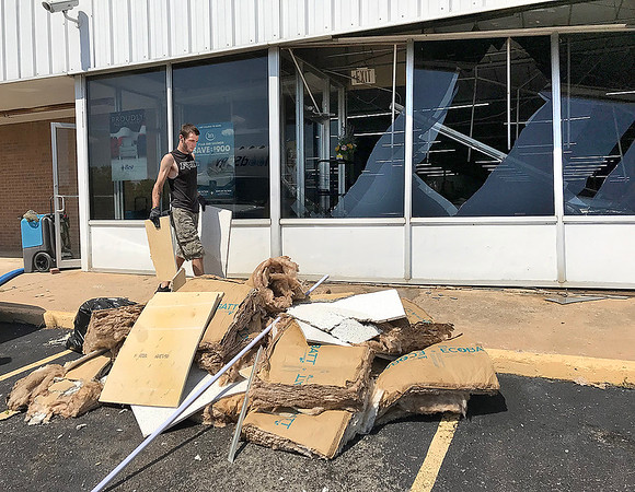 KEVIN HARVISON |<br /> Clean up continues on Bob Loftis Furniture store as crews remove debris from the building Wednesday morning.