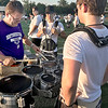 KEVIN HARVISON | Staff photo<br /> Dr. Sean DeNike, left, makes some adjustments on some equipment during a morning MHS Band practice at Hook Eales Stadium.