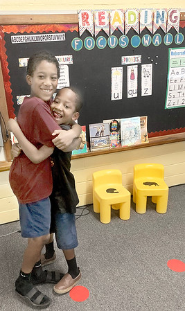 HAYDEN HARVISON | Submitted photo<br /> Cassius Grant and Lefarrie Grant play around during the recent Emerson Elementary School Family Night event.