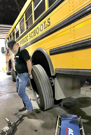 KEVIN HARVISON | Staff photo<br /> Robert Williamson works to repair a bus at the McAlester Public Schools transportation facility.