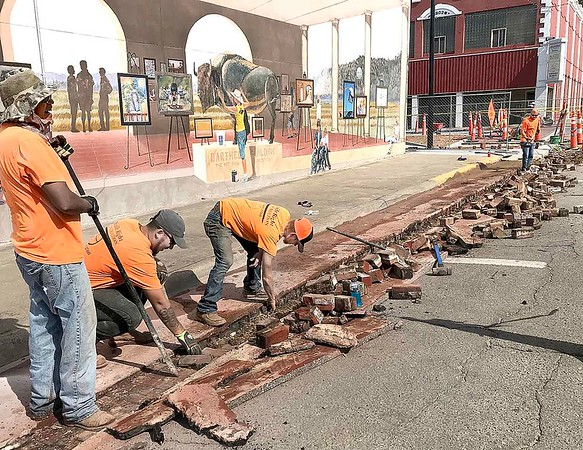 KEVIN HARVISON | Staff photo<br /> Work downtown continues as bricks from South Second Street near Choctaw Avenue are being removed for the downtown beautification project.