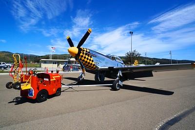 A P-51 Mustang parked at Half Moon Bay