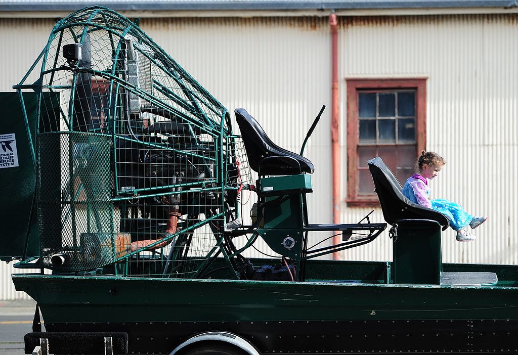 . (CHRIS RILEY �TIMES-HERALD) Ava Nelson, dressed in her princess gown, has her picture taken in an airboat during the SF Bay Flyway Festival on Mare island in Vallejo on Saturday.