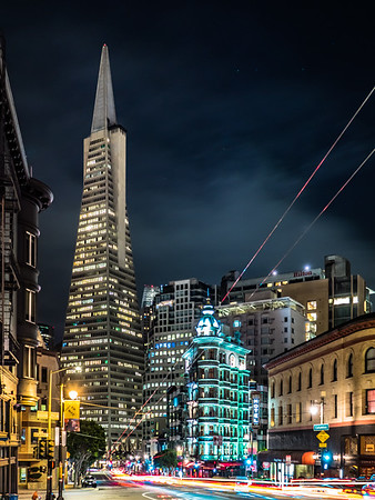 The Sentinel Building and Transamerica Pyramid looking down Columbus. Captured with the @getolympus OM-D E-M1 MKii, 17mm/f1.2 Lens in Live Composite mode, 1.6sec base exposure, for about 1 minute.  Supported by the @reallyrightstuff TVC-24L tripod and BH-55 ball head.  