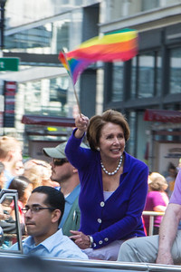 Representative Nancy Pelosi waves the Pride Flag