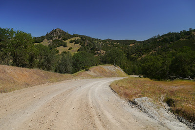 Back on the main road, closed to vehicles right now, I hike down to Pacheco creek to cross over towards Tie Down Peak, now looking more impressive.
