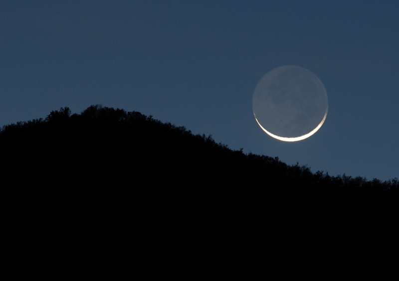 Moonset<br /> Photo by Dave