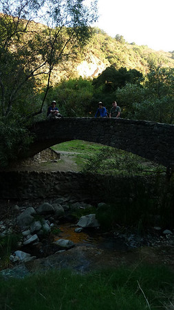 The crew on an old  bridge.