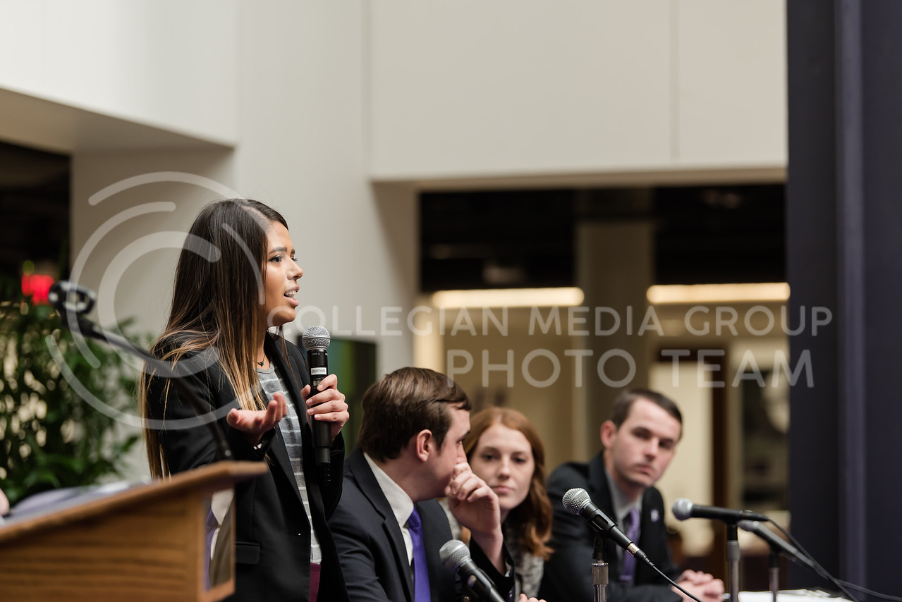 As she stands at the table with the other presidential candidates, junior candidate Paloma Roman states her platform to the audience. The Kansas State University Student Governing Association had their 2018 presidential candidate debate at the K-State Student Union on Monday. (Olivia Bergmeier   Collegian Media Group)