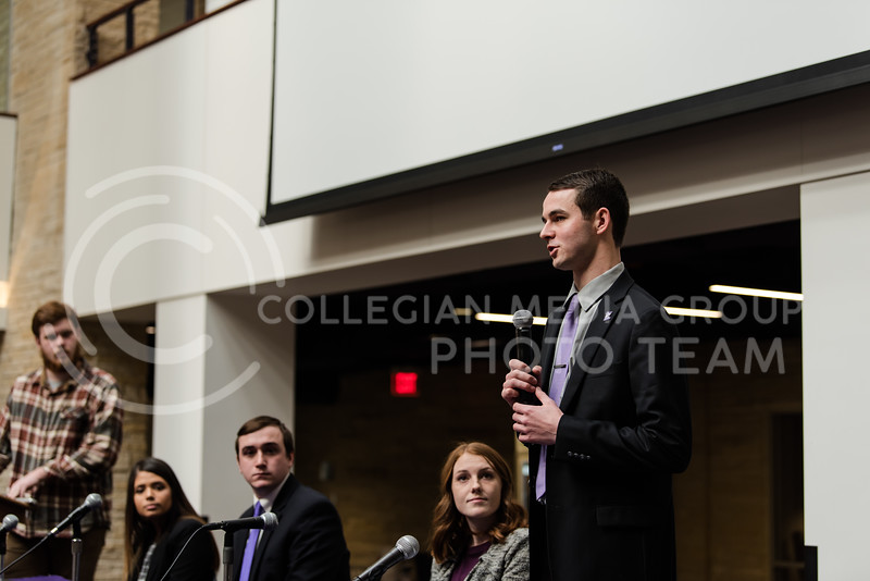 Mic in hand, senior presidential candidate Will Moreland shares his platform ideas with the audience. The Kansas State University Student Governing Association had their 2018 presidential candidate debates at the K-State Student Union on Monday. (Olivia Bergmeier | Collegian Media Group)