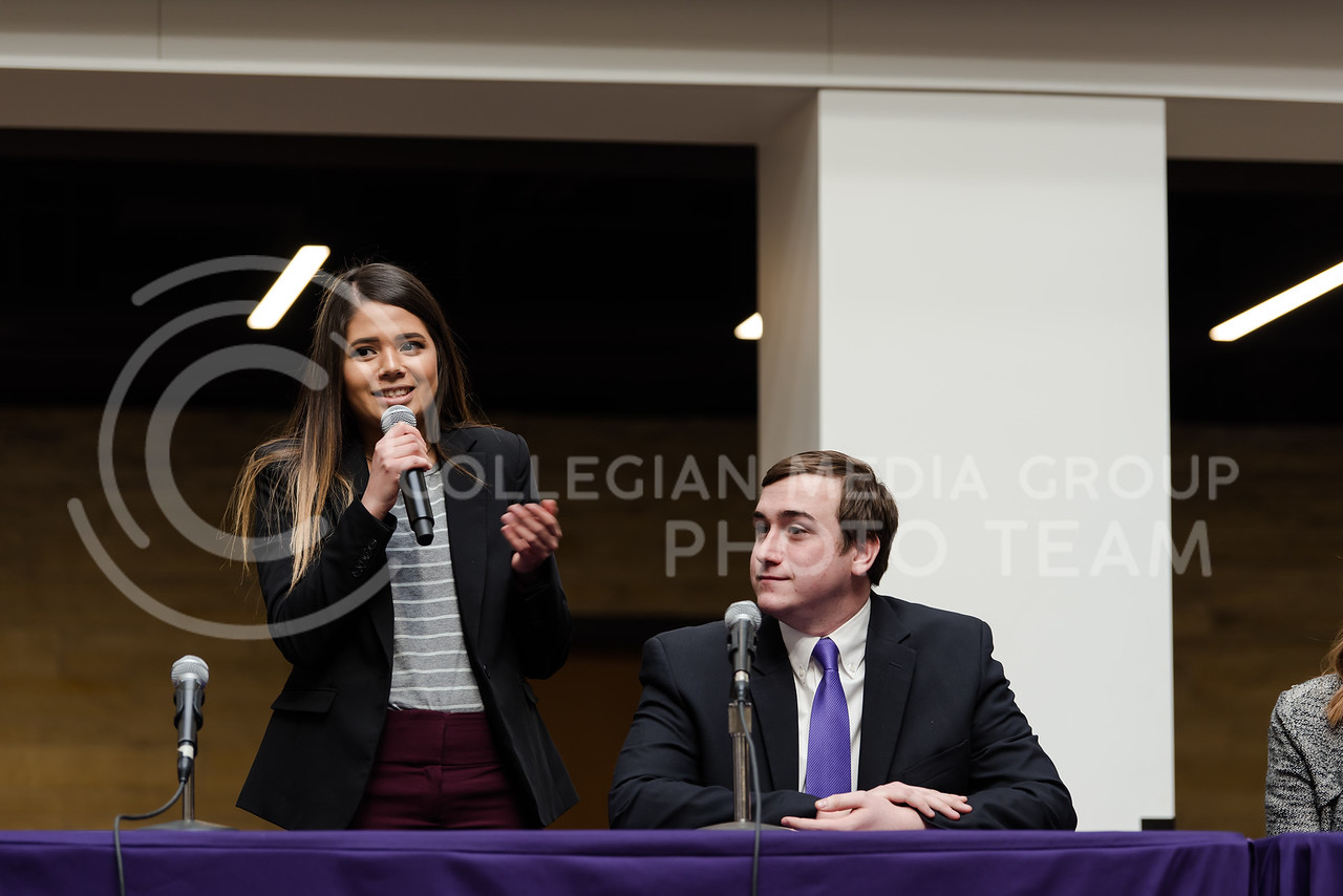 As she states her platform, junior presidential candidate  Paloma Roman smiles to the audience. The Kansas State University Student Governing Association had their 2018 presidential candidate debate at the K-State Student Union on Monday. (Olivia Bergmeier   Collegian Media Group)