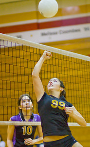 Apaches' Madyson Cassidy (99) punches the ball over the net as the Brahmas' Kathleen Torres (10) looks on during a first round CIF Playoff volleyball match between the Arcadia High School Apaches and the visiting Diamond Bar Brahmas in Arcadia, CA on November 10, 2009.  (STAR/TRIB/Correspondent photo by David Thomas/SPORTS)