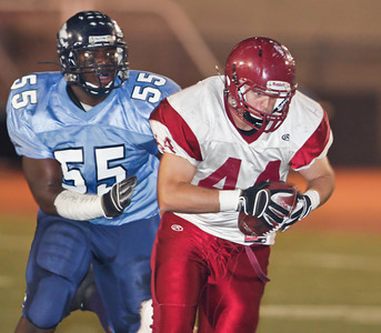 The Apaches' David Schuil (44) runs back an interception while being pursued by the Falcons' Sam Campbell (55) during the first quarter of a football game between the Crescenta Valley High School Falcons and the visiting Arcadia High School Apaches in Glendale, CA on November 12, 2009.  (STAR-NEWS/Correspondent photo by David Thomas/SPORTS)