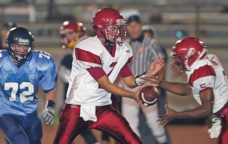 Apaches' quarterback Garrett Tuck (7) hands the ball to Rodney Arnett (5) during a football game between the Crescenta Valley High School Falcons and the visiting Arcadia High School Apaches in Glendale, CA on November 12, 2009.  (STAR-NEWS/Correspondent photo by David Thomas/SPORTS)