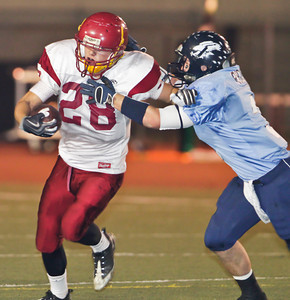Falcons' Kevin Rignot (3) tackles the Apaches' Taylor Lagace (28) during a football game between the Crescenta Valley High School Falcons and the visiting Arcadia High School Apaches in Glendale, CA on November 12, 2009.  (STAR-NEWS/Correspondent photo by David Thomas/SPORTS)