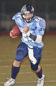 Falcons' Harry Pessy (24) runs for yardage during a football game between the Crescenta Valley High School Falcons and the visiting Arcadia High School Apaches in Glendale, CA on November 12, 2009.  (STAR-NEWS/Correspondent photo by David Thomas/SPORTS)